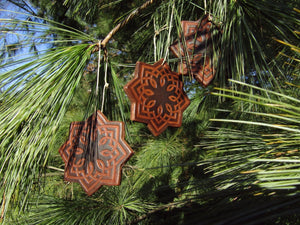 Set of three rustic star leather ornaments. Dark brown.