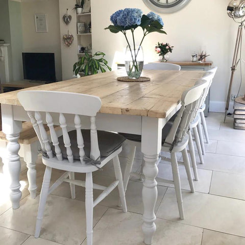 farmhouse dining table made from reclaomed wood with matching chairs and bench