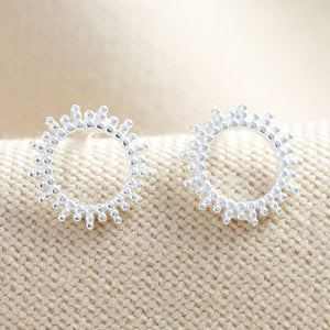 silver dotted sun earrings