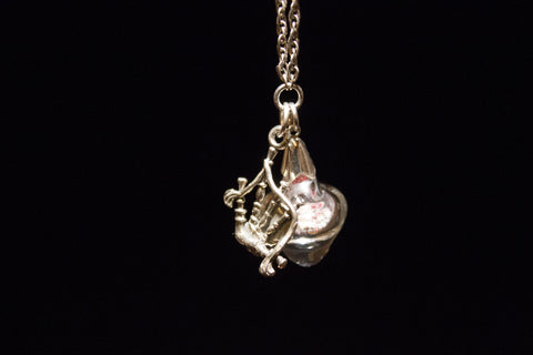 Encased Heart glass piece on a Sterling silver chain. Irish and Celtic Cremation Memorial Jewelry