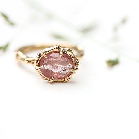 Peach Pink Umba Sapphire Engagement Ring styled image