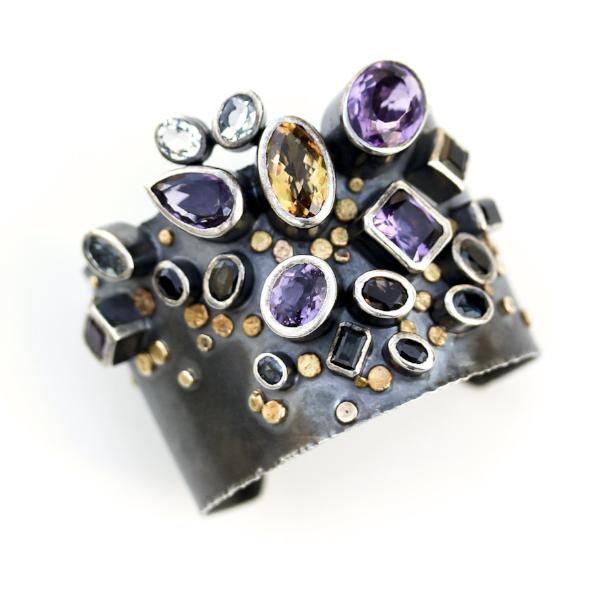 Handmade one of a kind bangle in oxidized sterling silver with Amethyst, Citrine, Topaz, Tourmaline, and Sapphire with 18K Gold dots