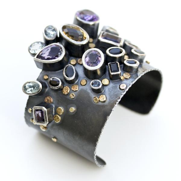 Handmade one of a kind bangle in oxidized sterling silver with Amethyst, Citrine, Topaz, Tourmaline, and Sapphire with 18K Gold dots, side view