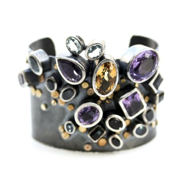 Handmade one of a kind bangle in oxidized sterling silver with Amethyst, Citrine, Topaz, Tourmaline, and Sapphire with 18K Gold dots, detail