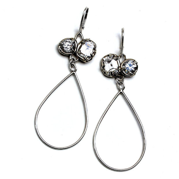 White topaz and sterling silver lever back earrings with long tear drop shaped dangle.