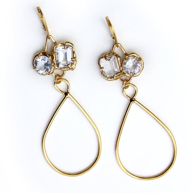 Gold dangle earrings with organic prong set White topaz gemstones and long golden tear drop shaped accents.