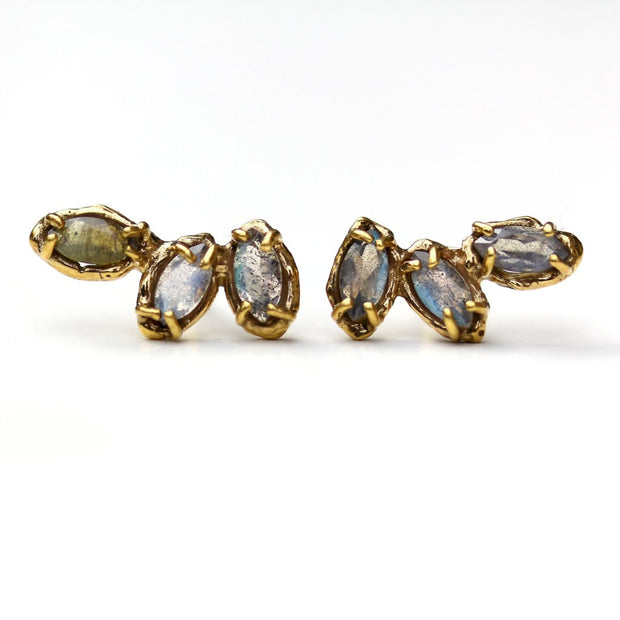 Stud earrings made of three marquise shaped labradorite gemstones set with organic prongs.