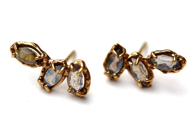 Organic looking stud earrings with prong set labradorite gemstones.