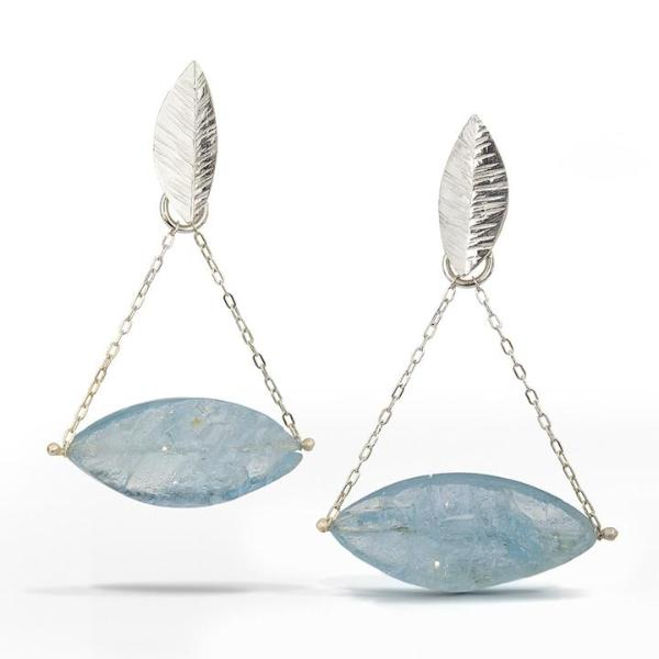 Chandelier Earring with marquise-shaped raw surface aquamarine stones freely hanging from delicate chain and small sterling silver leaves.