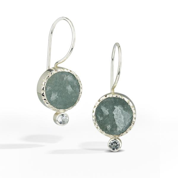 French wire earrings with round raw surface aquamarine gemstone is accented with a small pale blue topaz.