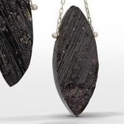 Detail photo of raw surface black tourmaline gemstones