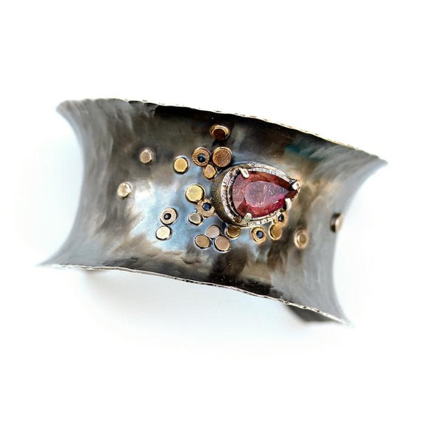 A statement cuff bracelet made from oxidized sterling silver.