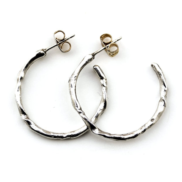 Sterling silver twig hoop earring.