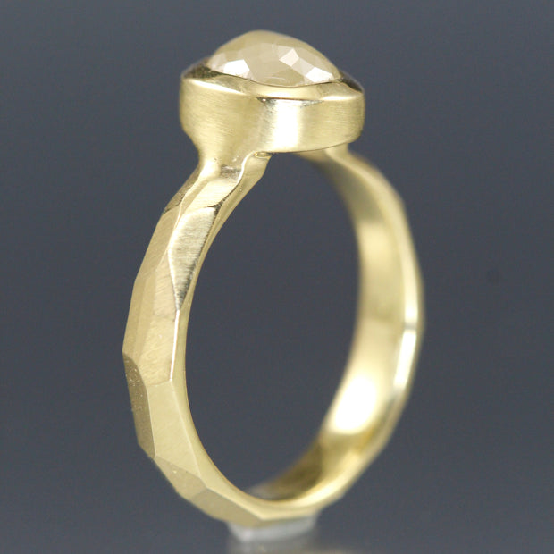 Side view of a yellow gold ring with a creamy yellow rose cut diamond.