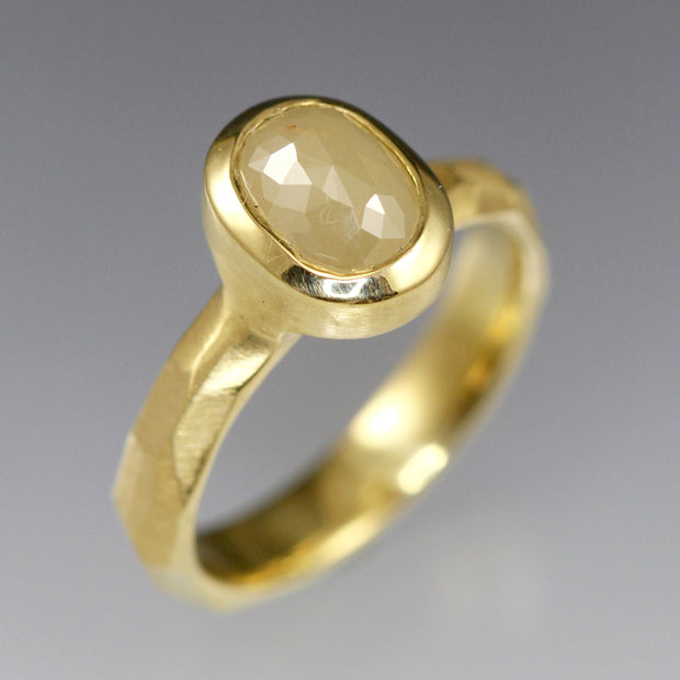 A creamy natural colored rose cut diamond solitaire ring in 18k yellow gold.