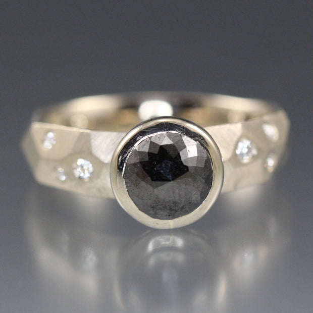 A bezel set black rose cut diamond ring with brilliant cut diamonds flush set in 14k white palladium gold.