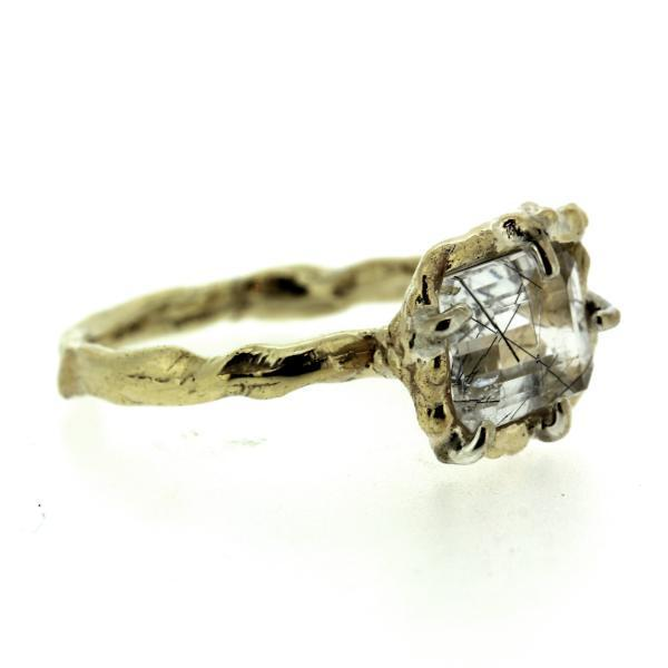 Side view of an organic inspired ring made in 14k yellow gold and tourmalinated quartz