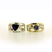 Color change sapphire, diamond, and 18K gold organic ring by Katie Poterala Jewelry, side by side with Iolite and pink sapphire ring in sterling silver