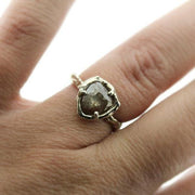 Salt and Pepper colored rose cut diamond ring in a woman's finger