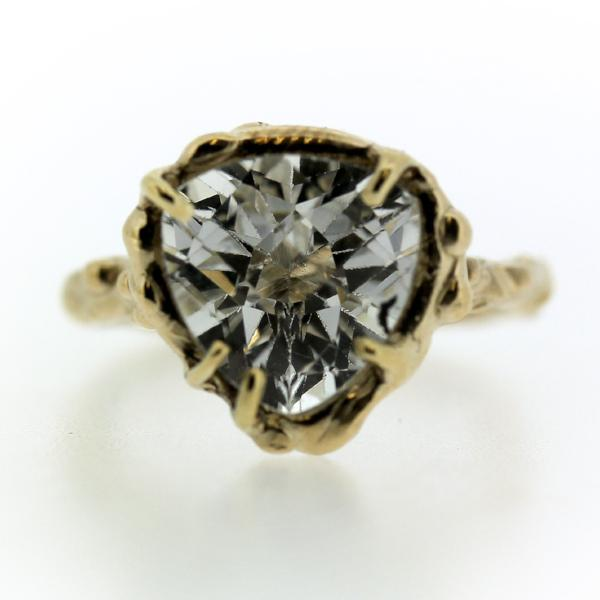14k yellow gold and Trillion shaped white topaz ring in an organic prong setting