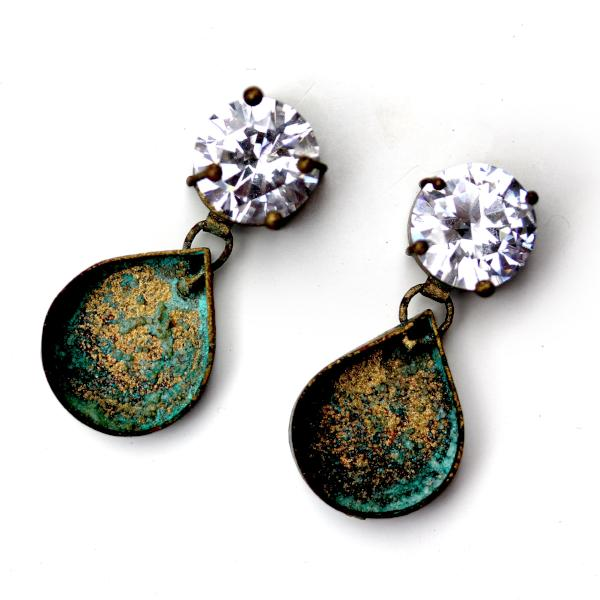 A pair of earrings with a sparkling CZ on top and an Earthy Patinated Copper tear drop shape dangle.