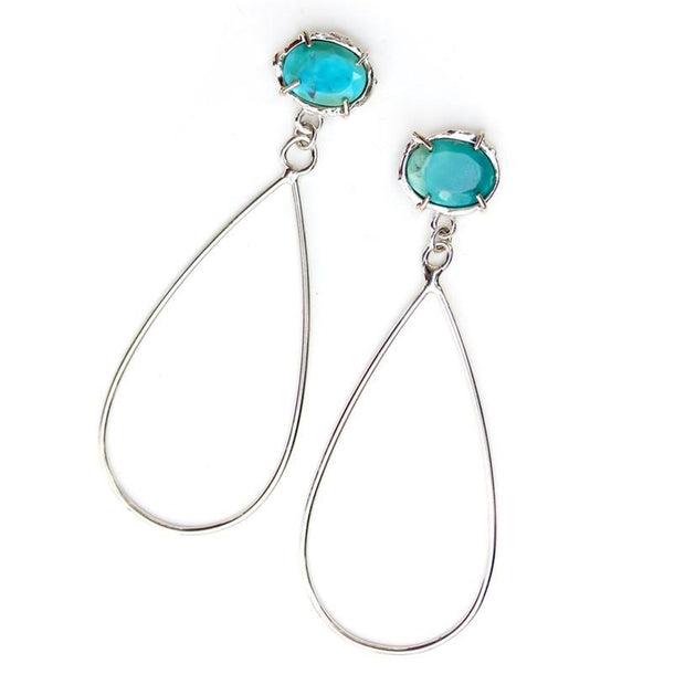 Prong set Turquoise and sterling silver earrings with tear-drop shaped dangle.