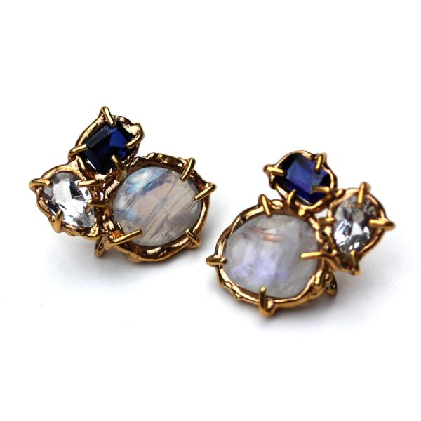 Stud earrings with lab sapphire, moonstone and white topaz, clustered together in an organic 14K yellow gold setting.