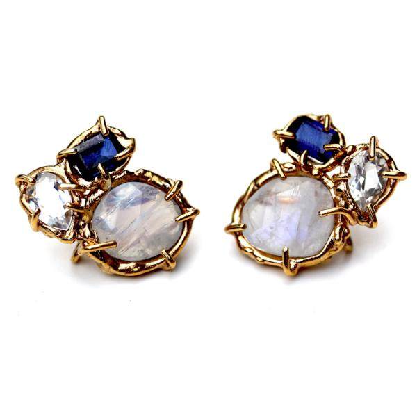 Stud earring with lab sapphire, moonstone and white topaz, clustered together in an organic 14K yellow gold setting.
