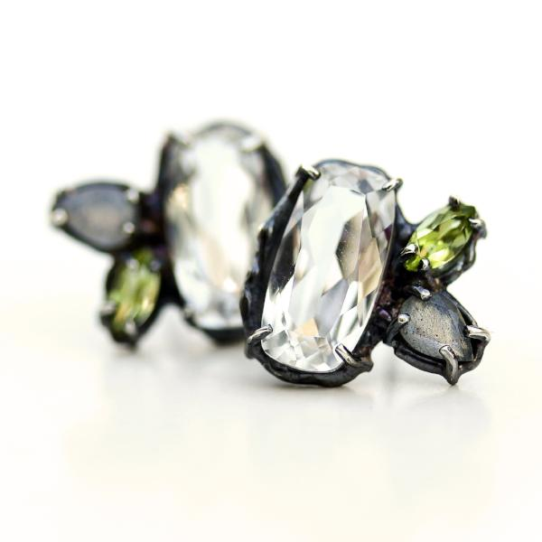 Stud earrings with white topaz, peridot and labradorite clustered together in an organic blackened sterling silver setting.