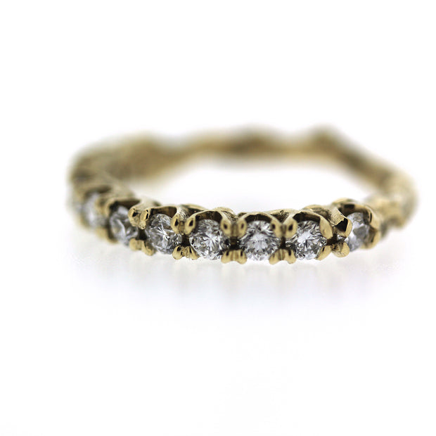 ethically made 2mm diamond engagement half eternity band with unique organic texture and side viewing, detail image of diamonds and prongs