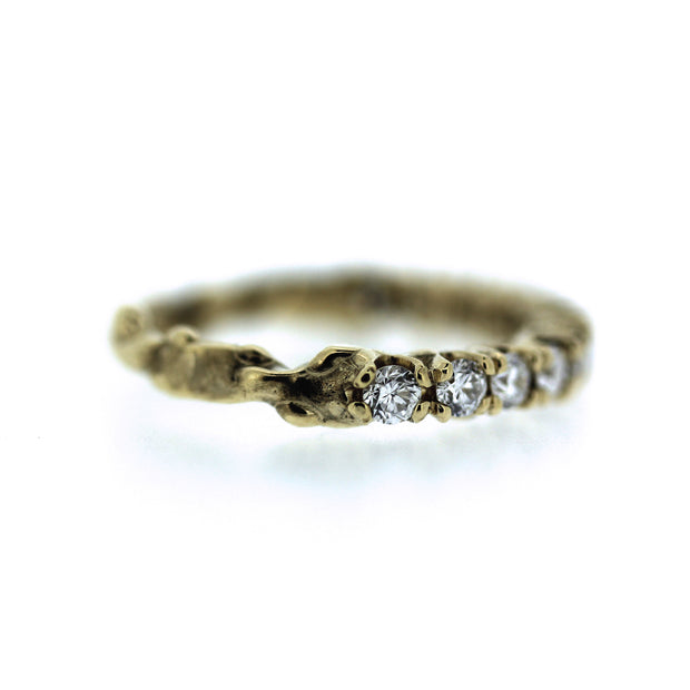 2mm diamond engagement half eternity band with unique organic texture and side viewing, detail shot of end of diamonds and start of textured band