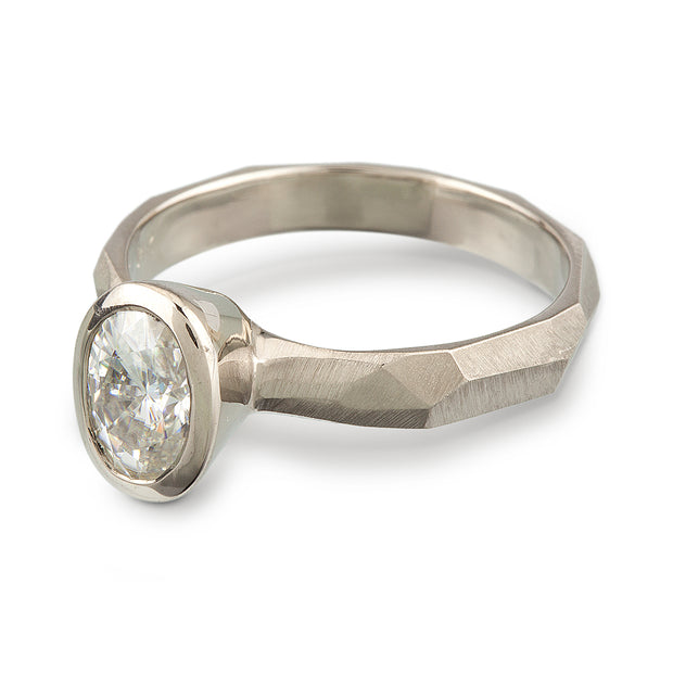 Bezel Set Oval Engagement Ring featuring a organic faceted band in 14k white gold