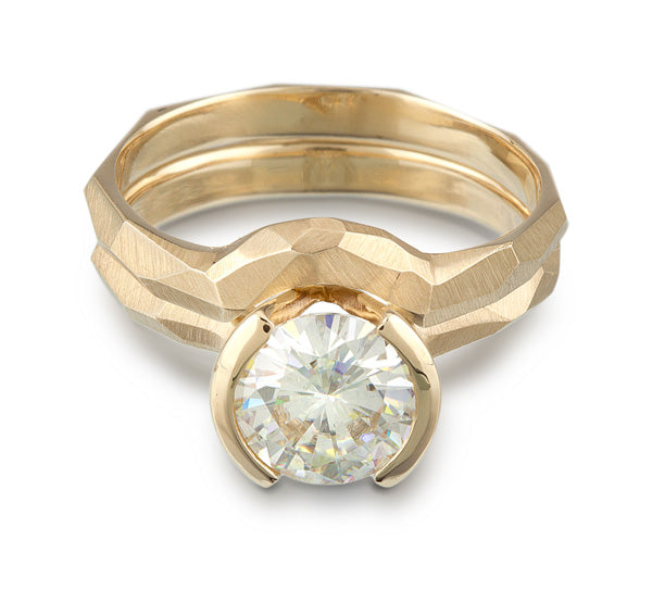 Contoured Wedding Ring and Engagement ring set in 14k gold, featuring a faceted metal look.