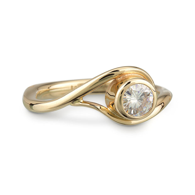 Yellow Gold and Moissanite Engagement Ring, the metal gently wraps around the stone, like a vine or wave.