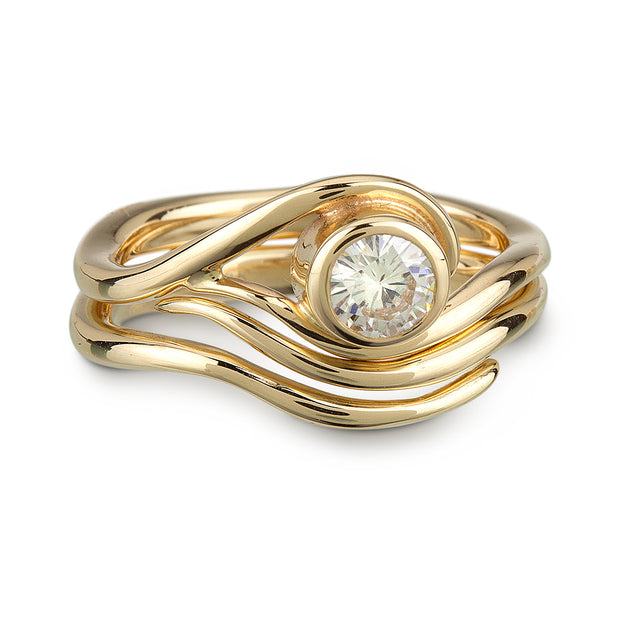 A Vine inspired Yellow Gold and Moissanite Engagement ring and nesting wedding band.