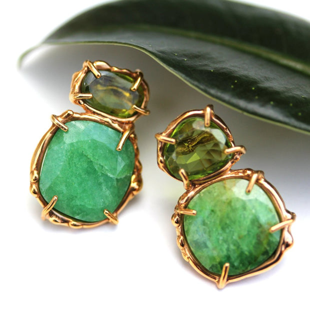 Organic prong set emerald and peridot stud earrings in vermeil.