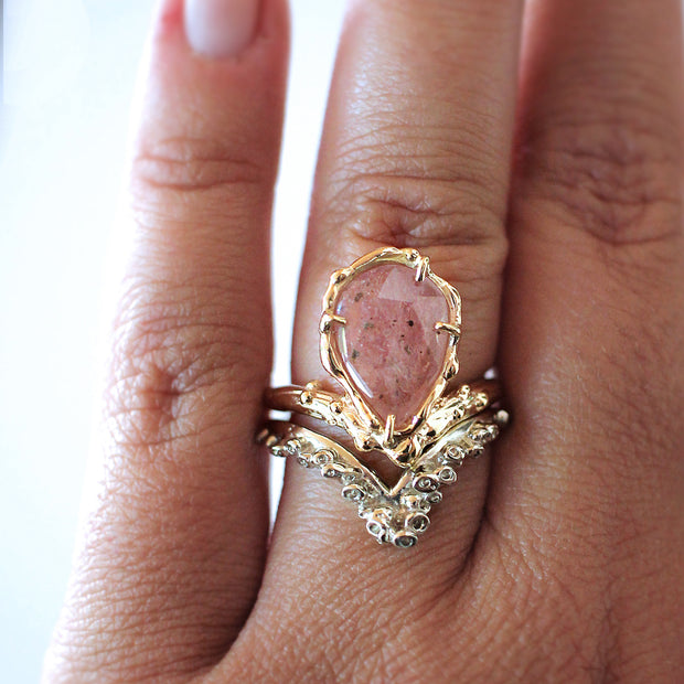unique arched engagement ring with sapphire