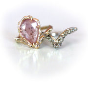 Pale pink sapphire engagement ring and ocean inspired, nautical or coral reef inspired band