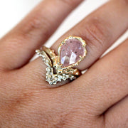 unique alternative engagement ring set featuring pink sapphire and organic texture