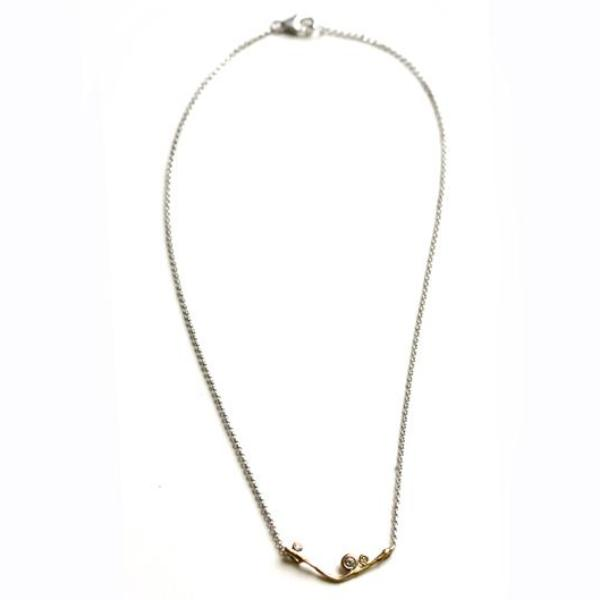 Yellow gold V-style necklace with three small accent diamonds.