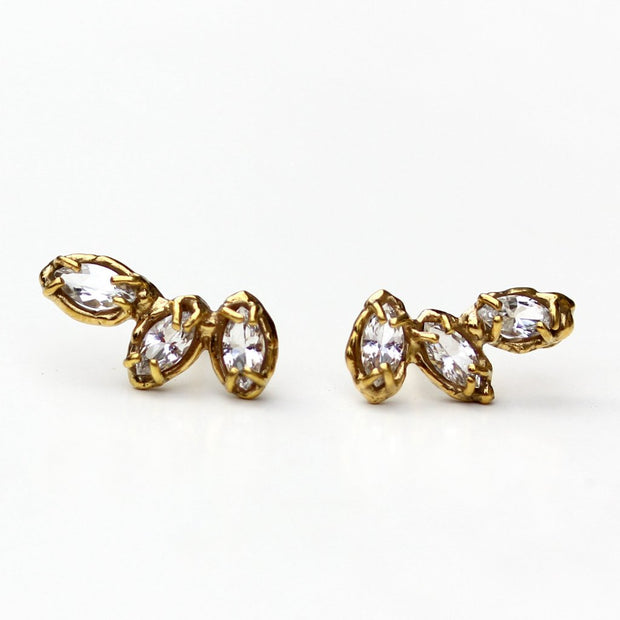 Stud earrings made of three marquise shaped white topaz stones set with organic prongs