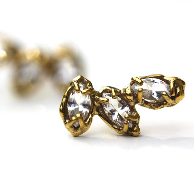 detail photo of Stud earrings made of three marquise shaped white topaz stones set with organic prongs