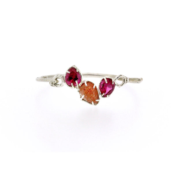 Lab Grown Ruby and Sunstone Pear shaped cluster on Sterling silver organic bangle with flip closure