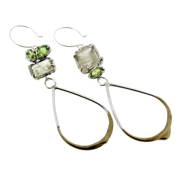 Slightly asymmetrical earrings handmade in sterling, rutilated quartz and peridot, a mismatched pair by Katie Poterala Studio