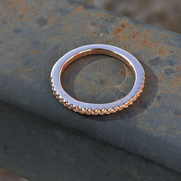 top view handmade micropave wedding band in rose gold and ethical lab grown diamonds