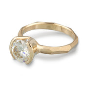 Modern 14k yellow gold Engagement Ring with a Partial Bezel containing a Moissanite Stone