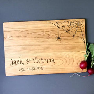 Halloween cutting board with custom names and spiderweb.
