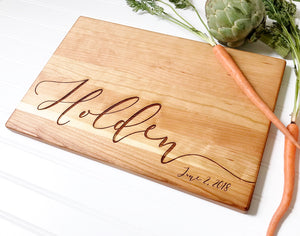Personalized cutting board with calligraphy name.