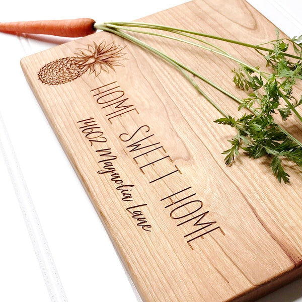 Personalized Home Sweet Home Cutting Board with Pineapple and Custom Address.