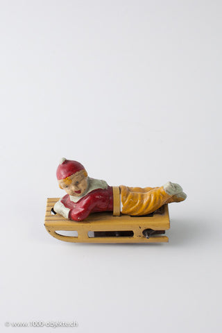 Gescha figure boy on sled, 50's.